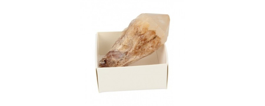 Raw gemstones and minerals in box